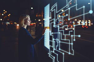 Woman using self-service technology screen