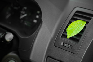 Green leaf attached to car air vent to make the car smell nice