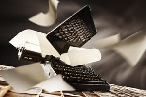 iPad falling ontop of an old typewriter