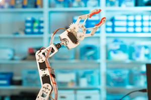 Industrial robot arm working in store room