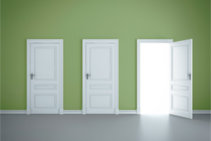 Three white doors in a green room and the third door is open