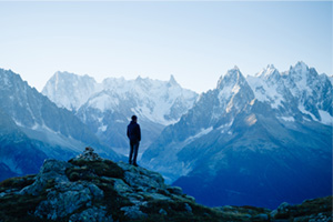 Person looking out over the mountains