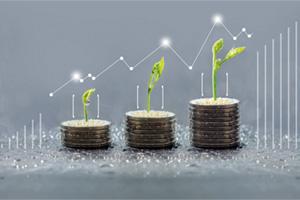 Plants growing on coins symbolising savings