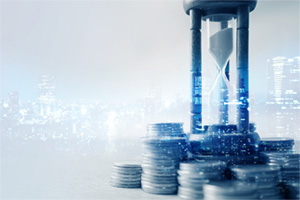 Hourglass timer surrounded by coins with a city double exposure in the background
