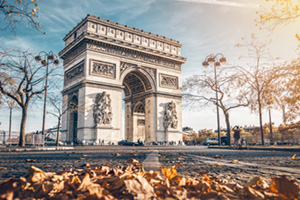 Arc de Triomphe located in Paris, in autumn scenery