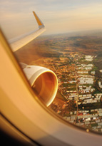 View out of aeroplane window, flying over city