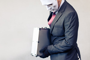 Business oerson in disguise, wearing a mask and stealing confidential suitcase