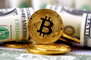 Bitcoin coins ontop of dollar notes