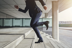 Business man running up stairs, late concept