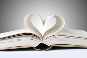 Open book with the middle pages creating a heart shape