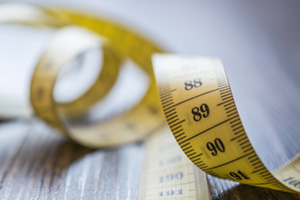 Yellow measuring tape loosely spread on table