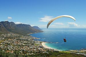 Paraglider hovering over Cape Town, South Africa