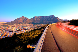 Beautiful view of Table Mountain in Cape Town from Signal Hill and some light streeks from cars