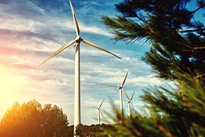 Wind turbine located in field outside city