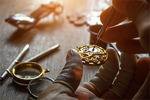 Watchmaker repairing mechanical watch