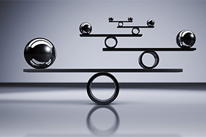 Business and lifestyle balance concept with balanced metal balls
