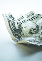 Single dollar bill crumpled