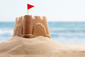 Childs sand castle on the beach