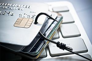 Credit card phising, fishing hook through credit card