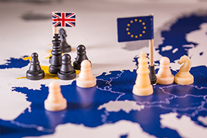 Chess pieces on map of Europe with the UK and EU flags