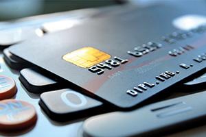 Bank cards laying ontop of a calculator