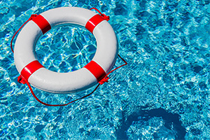 Lifebuoy floating in a swimming pool in the sun