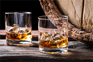 Two glasses of whisky by the barrel