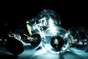 Group of lightbulbs in the dark