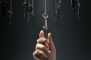 Hand reaching for key that is hanging