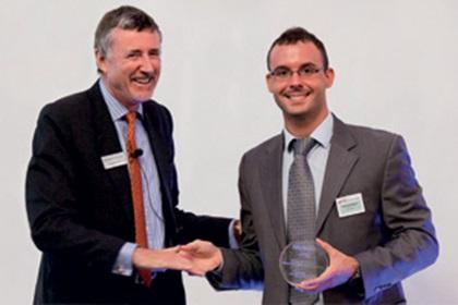 Richard Parkinson and Jose Luis Marti accepting on behalf of Microsoft