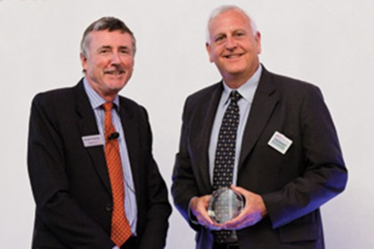 Richard Parkinson and Kevin McKenna from Brocade Communications accepting on behalf of Jean Furter and Yun Kong