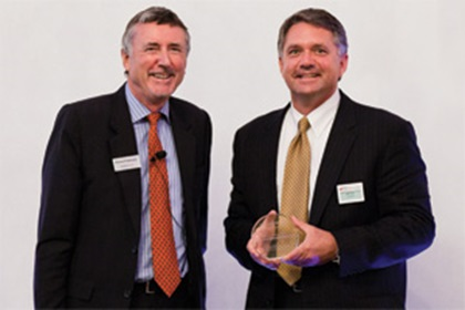 Richard Parkinson and John Tus from Honeywell accepting the award on behalf of Susan Puente-Duany