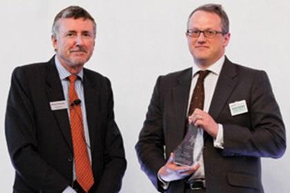 Richard Parkinson and Jonathon Traer-Clark from Hewlett- Packard accepting on behalf of Andrew Simanek