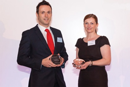 Photo of Mark Slaviero, Mattioli Woods accepting on behalf of Nathan Imlach, with Suzanne Burgoyne, Lloyds Bank