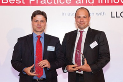 Photo of Gonzalo Erroz, Allstate Insurance Co and David Aldred, Citi accepting on behalf of Mark Madeyski