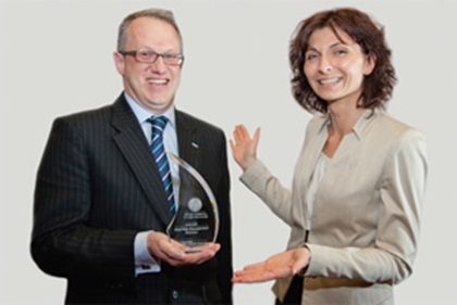 Photo of Jonathon Traer-Clark and Aleksandra Siwinska from Hewlett-Packard accepting on behalf of Zac Nesper
