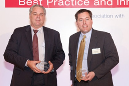 Photo of Peter Seward, Reval and Mark Turner, Ford accepting on behalf of Dennis Tosh