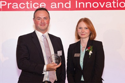 Photo of Andrew P. Reid from Deutsche Bank accepting on behalf of Sany Group with Eleanor Hill