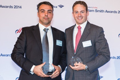 George Pittas of Ericsson collecting the Award on behalf of Ragnar Lodén and Mark Tweedie of Citi