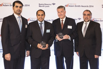 Rashed Al Qubaisi of Abu Dhabi Health Services Company collecting the Award on behalf of Bernhard Solleder and Howard Gaunt and Mohamed Al Ali of Abu Dhabi Commercial Bank