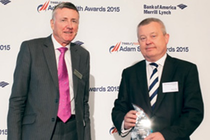 Richard Parkinson and Steve Hall from J.P. Morgan collecting the award on behalf of Debbie Donovan, Baker Hughes
