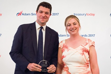 Geoff Gursel, Citi collects the award on behalf of Nigerian Breweries and Meg Coates
