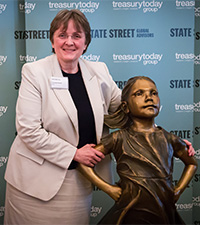 Cornelia Hesse from BASF having her photo taken with the Fearless Girl