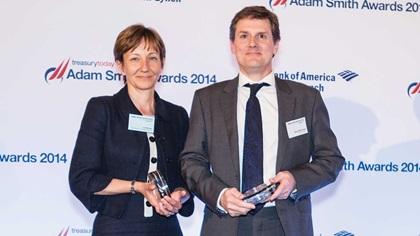 Jo Woods of Boston Consulting Group collecting the Award on behalf of Mark Salehar and David McGowan of BNP Paribas