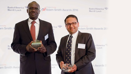 Photo of His Excellency Lazarus Amayo and Amit Agarwal standing on stage