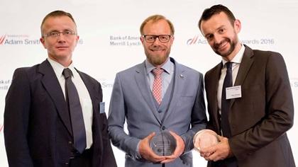 Zsolt Tajti and Marco Brähler, and Heiko Schwalb standing on stage