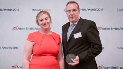 Photo of Meg Coates with David Jones, HSBC who accepts the award on behalf of Transport for London.
