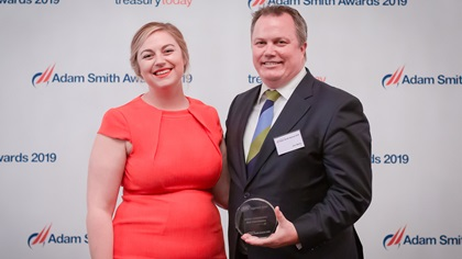 Photo of Meg Coates with Jim Mahn, Citi, collects the award on behalf of Ingersoll Rand.