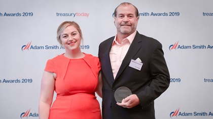 Photo of Meg Coates with Tom Newton, ICD, collects the award on behalf of Cisco Systems.