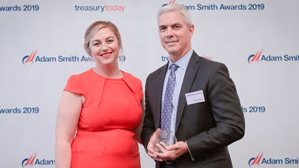 Photo of Meg Coates with Tod Van Name, Bloomberg, collects the award on behalf of Etisalat Group.